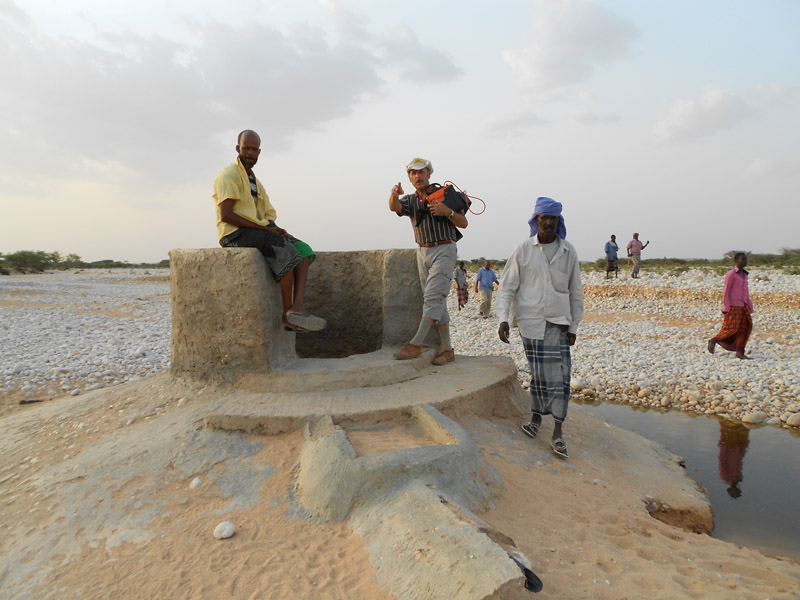 Dried up, dug wells in the riverbed in Puntland, Somalia. Fogdestam together with some villagers.